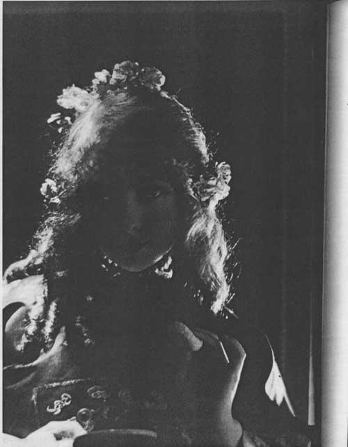 Shadowed woman in costume