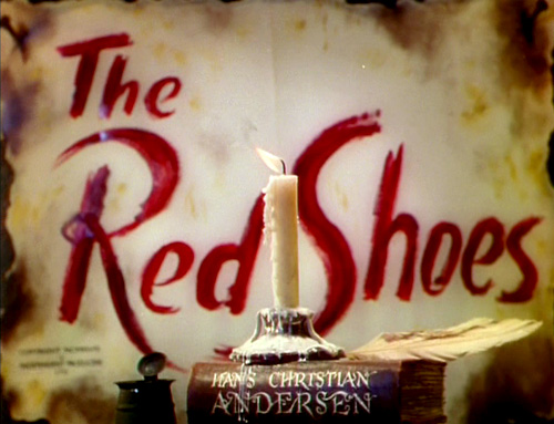 The Red Shoes logo, book with swash characters