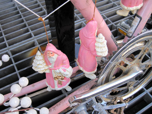 Bike with pink Santas and cranberries