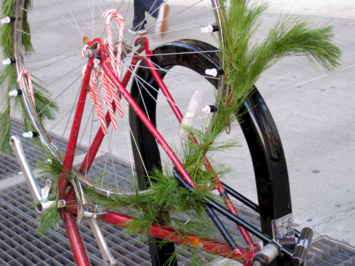 Bike decorated with wreath, candycanes & manifesto