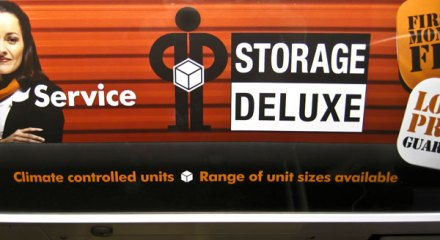 Storage Deluxe logo = SNL d*ck in a box